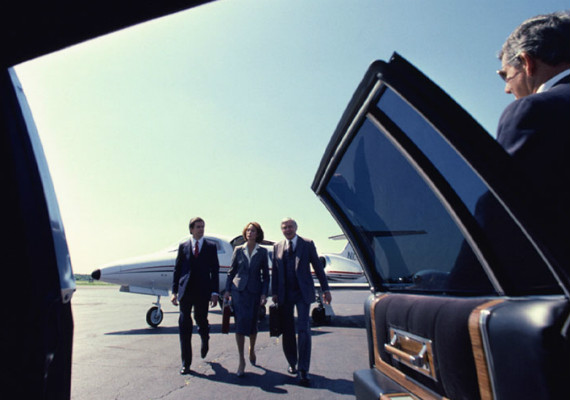group of people walking up to limousine door
